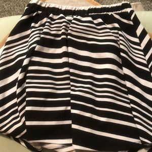 Striped , mid thigh skirt